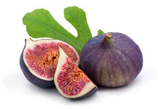 Some fresh,juicy figs with green leaves Royalty Free Stock Photos