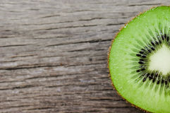 Some fresh Kiwi Fruits on an old wooden table. Some fresh Kiwi Fruits (selective focus) on an old wooden table, half of kiwi stock photos