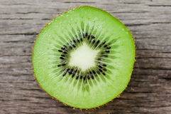 Some fresh Kiwi Fruits on an old wooden table Stock Photos