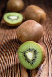Some fresh Kiwi Fruits. (selective focus) on an old wooden table Royalty Free Stock Photo