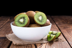 Some fresh Kiwi Fruits. (selective focus) on an old wooden table royalty free stock images