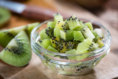 Some fresh Kiwi Fruits. (selective focus) on an old wooden table Royalty Free Stock Photography