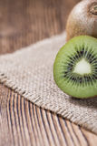 Some fresh Kiwi Fruits. (selective focus) on an old wooden table Stock Image