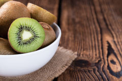 Some fresh Kiwi Fruits. (selective focus) on an old wooden table royalty free stock image