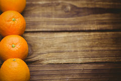 Some Fresh large juicy oranges. Fresh oranges on wooden background Royalty Free Stock Photo