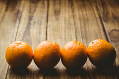 Some Fresh large juicy oranges. Fresh oranges on wooden background Stock Photo