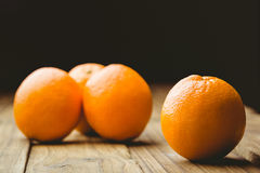 Some Fresh large juicy oranges. Fresh oranges on wooden background Stock Image