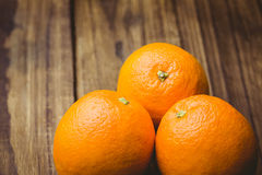 Some Fresh large juicy oranges. Fresh oranges on wooden background Royalty Free Stock Photography