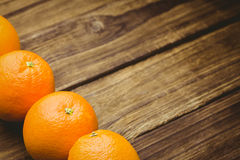 Some Fresh large juicy oranges. Fresh oranges on wooden background Stock Images