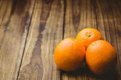 Some Fresh large juicy oranges. Fresh oranges on wooden background Royalty Free Stock Photos