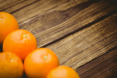 Some Fresh large juicy oranges. Fresh oranges on wooden background Stock Photos