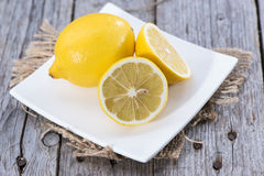 Some fresh Lemon Fruits. On wood Royalty Free Stock Images