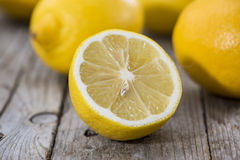 Some fresh Lemon Fruits. On wood Royalty Free Stock Photo