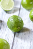 Some fresh Limes. (selective focus) on an old wooden table (close-up shot Stock Photos