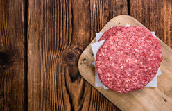 Some fresh made Burgers. (raw minced Beef) on an old wooden table stock photography