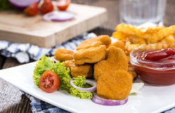 Some fresh made Chicken Nuggets (with chips). Some fresh made golden Chicken Nuggets with crispy chips Stock Photography