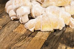 Some fresh made croissants. On wooden background. Macro shot Royalty Free Stock Photography