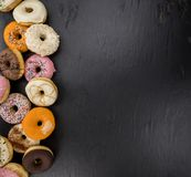 Some fresh made Donuts top view. Some fresh made Donuts view from above; close-up shot royalty free stock images