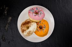 Some fresh made Donuts top view. Some fresh made Donuts view from above; close-up shot royalty free stock photos