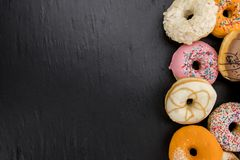 Some fresh made Donuts top view. Some fresh made Donuts view from above; close-up shot stock photography