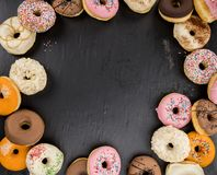 Some fresh made Donuts top view. Some fresh made Donuts view from above; close-up shot stock image