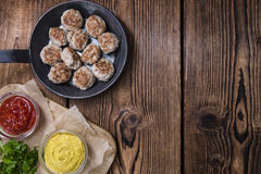 Some fresh made Meatballs. (selective focus) on wooden background Stock Image