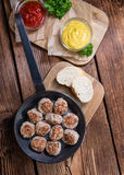Some fresh made Meatballs. (selective focus) on wooden background Stock Images