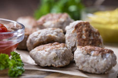 Some fresh made Meatballs. (selective focus) on wooden background Royalty Free Stock Photos