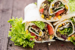 Some fresh made Wraps. On wooden background Royalty Free Stock Photos