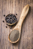 Some fresh milled Black Pepper. On wooden background (selective focus; close-up shot Royalty Free Stock Image