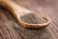 Some fresh milled Black Pepper. On wooden background (selective focus; close-up shot Stock Photo