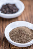 Some fresh milled Black Pepper. On wooden background (selective focus; close-up shot Stock Photos