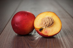 Some fresh nectarines over wooden background Royalty Free Stock Photos