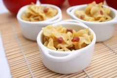Some fresh pasta with chese and bacon. Some fresh pasta with cheese and bacon royalty free stock photography