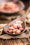 Some fresh Peanuts on wooden background Royalty Free Stock Photos