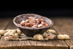 Some fresh Peanuts on wooden background Stock Images