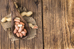 Some fresh Peanuts on wooden background Royalty Free Stock Photography