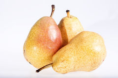 Some fresh pears isolated on white background. Close up Stock Images
