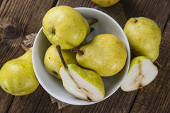 Some fresh Pears. (selective focus) on wooden background stock image