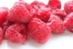 Some fresh raspberries. Some raspberries on white background Royalty Free Stock Photography