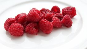 Some fresh raspberries. Some raspberries on white background Stock Photos