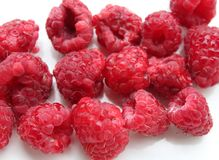 Some fresh raspberries. Some raspberries on white background Stock Photo