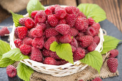 Some fresh Raspberries. On wooden background (detailed close-up shot Royalty Free Stock Photos