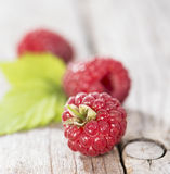 Some fresh Raspberries. On wooden background (detailed close-up shot Royalty Free Stock Images