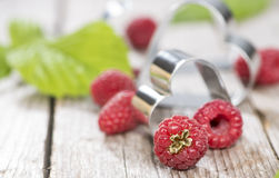 Some fresh Raspberries. On wooden background (detailed close-up shot Stock Photo