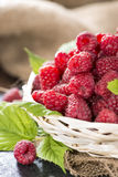 Some fresh Raspberries. On wooden background (detailed close-up shot Stock Photos