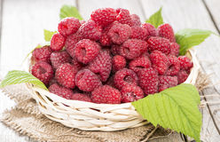 Some fresh Raspberries. On wooden background (detailed close-up shot Royalty Free Stock Photography