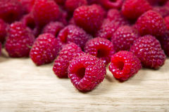 Some fresh raspberry. Fresh raspberry on a wooden table background Royalty Free Stock Photo