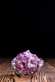 Some fresh Red Onions (diced). On an old wooden table royalty free stock images