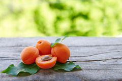 Some fresh ripe raw juicy apricot. On old wooden background Royalty Free Stock Photo